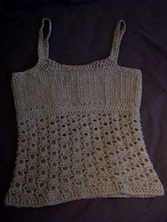 Perfect tank top based on other pics crocheter shared. Will probably replace fancier bottom stitches with new found extended single crochet (esc) for first attempt at this one. This is what I want for a basic under-the-shirt shirt. Crocheting is all about mixing colors ad infinitum so who cares if straps are hanging everywhere in different colors. Sounds more like crocheting's intended style, actually :)