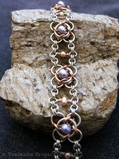 Sterling silver, copper, and freshwater pearl Not Tao 4 bracelet. Measures at 7.75 inches long and about 1/2 inch wide. Handmaden Designs LLC. $250