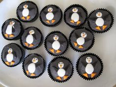 Penguin Cupcake.... I don't like black frosting though...  I bet they'd be cute on PINK