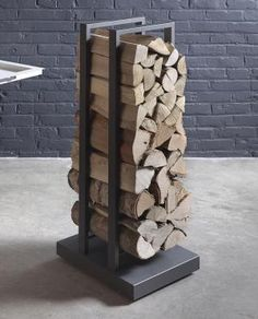 Mobile Log Holder - This contemporary log holder from stove experts Stuv is both stylish and functional, the entire stand is on wheels for easy movement and added convenience. The perfect solution for storing logs by your stove.
