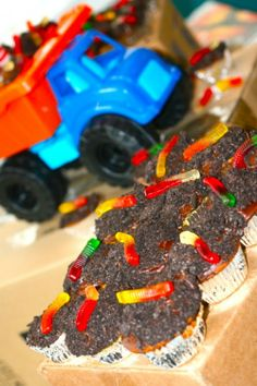 "Hahaha!  Awesome idea for a boy's party;  cupcakes, icing, dipped in crushed oreo crumbs with a gummi worm on top.  What kid would say ""no""?!"