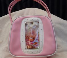 70's little girl purses with the doll inside