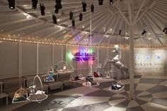 Futuristic funfair where products can be placed on trapeze and hoops!    The Shoes Shine in the Melissa Lounge in style fashion interior design  Category