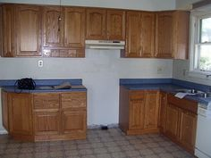 Kitchen - before DIY.  Looks like the old lake house kitchens.  Inspiring.