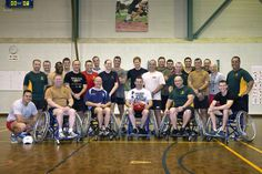 In this handout photo provided by the Australian Defence Force, Members of the Soldier Recover Centre pose with Prince Harry (C) after a game of wheelchair AFL at Robertson Barracks on April 15, 2015 in Darwin, Australia. Prince Harry has spent his first two weeks secondment in the Australian Army with the North-West Mobile Force (NORFORCE) and the 1st Brigade. (Photo by CPL Oliver Carter/Australian Defence Force via Getty Images) .. 19th April
