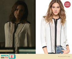 Tess's white blouse with black contrast trim on Beauty and the Beast. Outfit Details: http://wornontv.net/22800 #BeautyandtheBeast