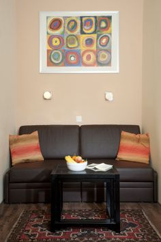 This apartment combines style with much coziness. Double bed or 2 single beds possible. Comfortable Sofa, Double Beds, Couch, Contemporary, Rugs, Furniture, Home Decor, Bedroom, Living Room