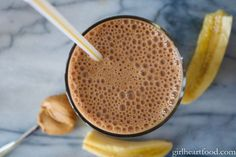 An overhead shot of a glass of Peanut Butter, Banana, Cocoa and Coffee Smoothie.