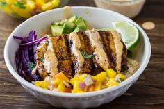 These Grilled Mahi Mahi Taco Bowls with Peach Mango Salsa and a Chipotle Mayo are loaded with flavor, a perfect paleo and Whole 30 meal for the summer!