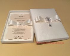 Luxury wedding invitation with crystal dangling brooch