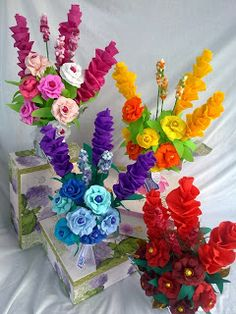Crepe paper flower arrangements with Easter eggs inside