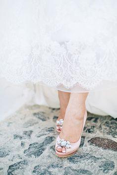Pacing the streets of the magical #Santorini! So alluring.  #weddingdetails #weddinginSantorini #realwedding #weddingshoes #miumiu