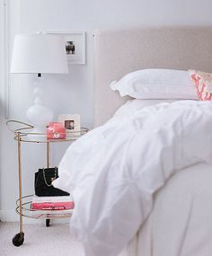 Use a glamorous bar cart as a nightstand.