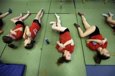 Members of the Crystal Palace diving club stretch during a training session in a dry diving gym in London March 9, 2012.  REUTERS/Stefan Wermuth
