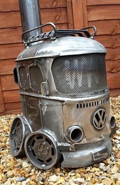 Bay window wood burning stove from creation fabrication! | If I didn't live in South Florida with absolutely no need for this, I would have one of these for my garage.They also sell splittys too cute | volkswagen vw bus #vwbus pinned by www.wfpblogs.com