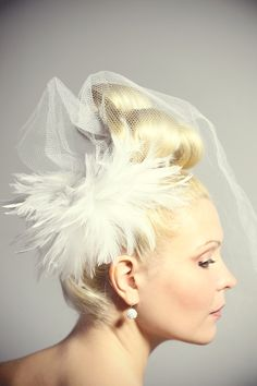 Lovely, interesting updo for a bride.  Hair by Emily Garbee Harris, photo by Crystal George Studios.