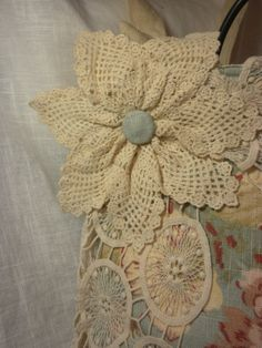 Antique Blue Floral Wrapped In Vintage Doilies by touchograce