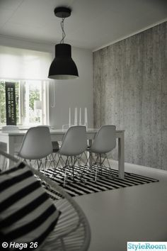 Dining room - concrete wall -  Eames chair - white table