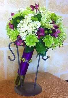 Bridesmaids' bouquet featuring green hydrangea, green athos mums, spider mums, hypericum berries and magenta alstroemeria lilies.