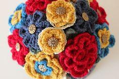 crochet flowers on top of a tea-cosy