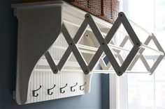 Stylish White Wooden Folding Rail Wall Drying Rack Bead Board With 5 Hook Clothing Hanger And Sweet Shelves For Rattan Laundry Basket In Country White Laundry Room Decor Ideas
