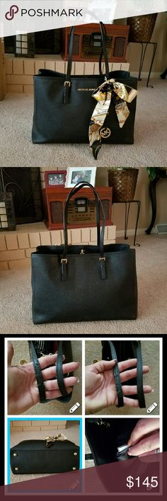 Michael kors Tote Authentic MK Medium Black Saffiano multifunction jet set tote. Scarf is a free gift w/purchase.Saffiano leather is in Great Condtn & shows no flaws.Gold Hardware is Perfect! one strap was cracked and has been repaired.the other strap is perfect. Interior is in Perfect/clean condition.3 Sections for great Organization.Holds enuff to b a Large purse not a med.but mk considers it Med. Will only Trade for like val item.Offer Systm only plz.im on M also ;) Michael Kors Bags