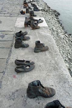 During World War II, the Arrow Cross (Hungarian Fascists) would take Jews from the Budapest ghetto down to the Danube River and shoot them so that they would fall into the river.  These shoes (bronze but in the style of that era) are lined up along the Embankment, not far from the  Hungarian Parliament.