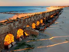 Caesarea Aqueduct  Israel- I love this place with it's beauty and history.....many ancient pieces of the past are here..washed up on the beach...