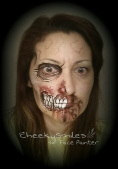 Scary Zombie half face by CheekySmiles Face Painter in Oklahoma City!