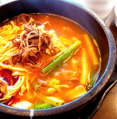 Yukgaejang is a spicy, soup-like Korean dish made from shredded beef with scallions and other ingredients, which are simmered together for a long time.
