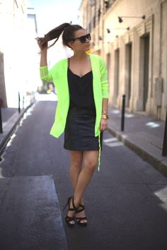 Easy Sunday Style from Frassy : a neon cardigan, black top, leather skirt, and a pony tail!