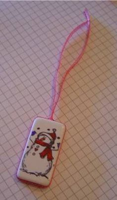 Domino Christmas Ornament Tutorial. Stamp image, color w sharpie.