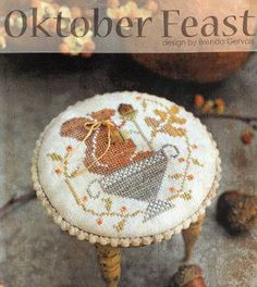 With Thy Needle and Thread Oktober Feast - Cross Stitch Pattern. Model stitched on 36 Ct. Legacy linen by Picture This Plus with Weeks Dye Work floss and Gentle