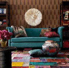 Captivating Turquoise Sofa Design Collection to Check Out: Alluring Turquoise Sofa with Silver Pouf and Nice Wooden Bookcase also Brown Wall Decor and Colorful Carpet in Amusing Living Room – Ewehome Interior Design Ideas and Furniture