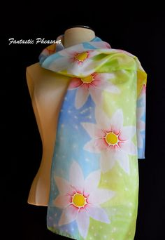 Silk scarf hand painted in soft pastel shades of blue and