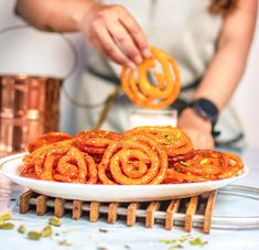 Jalebi is a quick and easy Indian style funnel cake recipe which is very popular throughout India. This juicy and crispy jalebi can be prepared under 30 minutes Jamun Recipe, Burfi Recipe, Chaat Recipe, Samosa Recipe, Recipe Recipe, Indian Snacks, Indian Food Recipes, Easy Indian Dessert Recipes, Snacks