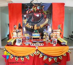 Backdrop and dessert / candy table for an Ironman / Avengers themed birthday party. Design and setup by ParteeBoo - The Party Designers