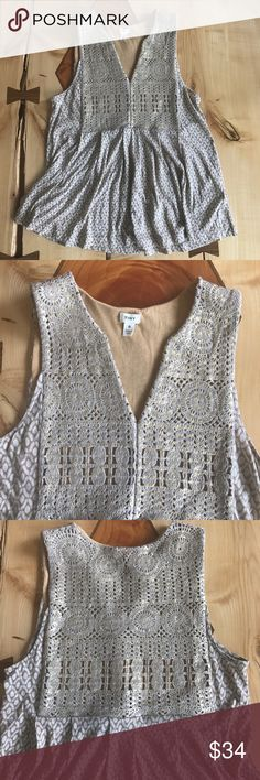 "Anthropologie Tiny Gold Embroidered Top Tiny brand, Sleeveless top with beautiful gold embroidery. The embroidered section has a soft fabric backing. Bottom part of Top is a soft cotton. Lying flat shoulder to hem 25"", pit to pit 17.5"". Excellent used condition Anthropologie Tops Tank Tops"