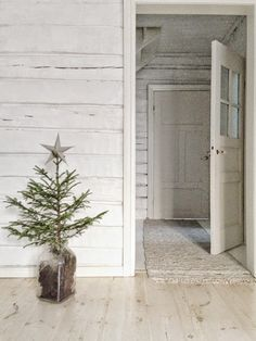 A little christmas tree ~ with a paper star ontop simple and plain Little Christmas Trees, Christmas Time, Merry Christmas, Xmas, Interior Styling, Interior Design, Paper Stars, Cabinet Makers, White Houses