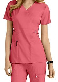 Look stylish at work with this beautiful mock wrap top from Cherokee Luxe (in Pink Violet)! Accents include piping around the neck and a self belt at the empire waist! Dental Uniforms, Work Uniforms, Nursing Uniforms, Beauty Therapist Uniform, Modest Dresses, Dresses For Work, Nursing Accessories, Cute Scrubs, Scrubs Uniform