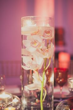 Elegant table centers created from submerged phalenopsis orchids