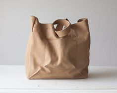 This Aella shopper tote bag made with a soft nude beige Italian leather. It is a simple leather shopper bag that is large enough to carry all your daily essentials and then some – a unique product by milloo via en.DaWanda.com