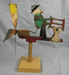 """MAN SAWING LOG"" Folk art Metal Whirligig"