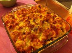 Baked tortellini with cream, gorgonzola, and ham