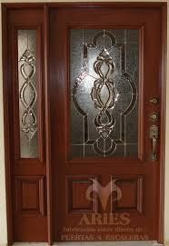 Entry door with sidelights exterior doors with one for Puertas principales de madera rusticas