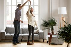 Happy romantic couple having fun in new home, man holding womans hand up leading in dance enjoying weekend, cheerful young family feeling excited spending time together in cozy modern living room living room interior royalty free stock images stock photo Meditation Room Decor, Meditation Cushion, Meditation Space, Best Of Intentions, Hard Floor, Bunch Of Flowers, How To Get Rich, Romantic Couples, Home Look