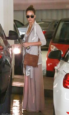 Pretty in pink: Jessica Alba ensured she dressed to impress as she stocked up on healthy p...