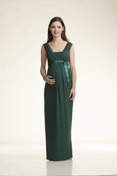 NATI, en color verde oscuro con cinturón de raso. Es un precioso y fresco vestido en algodón, ideal para cualquier evento que requiera elegancia y distinción.
