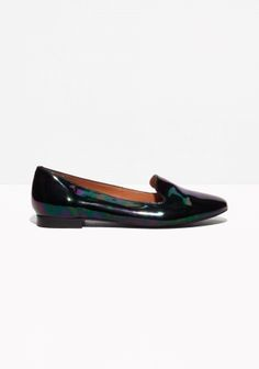 Clean and minimalistic, these loafers have a masculine touch, crafted from intriguingly oily-like, iridescent leather.