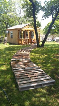 Pallet walkway. Dig into ground